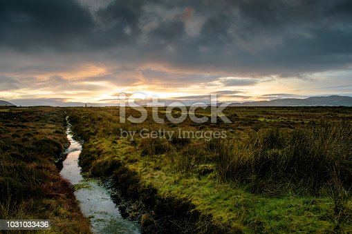 This is an bog on a mountain in Donegal Ireland at sunset.