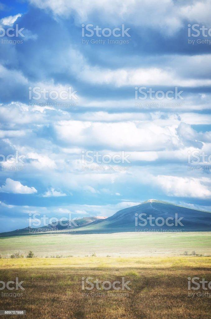 Bogdo mountain under beautiful sky. Panorama of steppe near salt lake Baskunchak stock photo