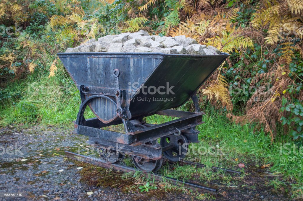 Bogie filled with granite rubble stock photo