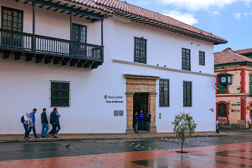 Bogotá Colombia - Looking Across Calle 11 In La Candelaria Towards the Entrance To The Casa de Moneda. Spanish Colonial Architecture And A Little Rain.