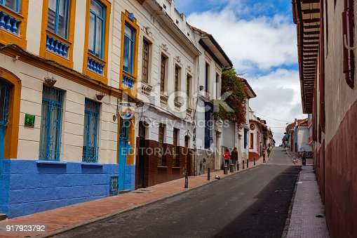 istock Bogotá, Colombia - Looking Up One Of The Colorful Streets Of The Historic La Candelaria District In The Capital City 917923792