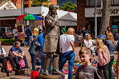 Bogotá, Colombia - The Weekly Mercado de Las Pulgas in the Popular, Historic Usaquén Town Square on a Bright Sunday Afternoon. A Mime Artist Entertains Visitors