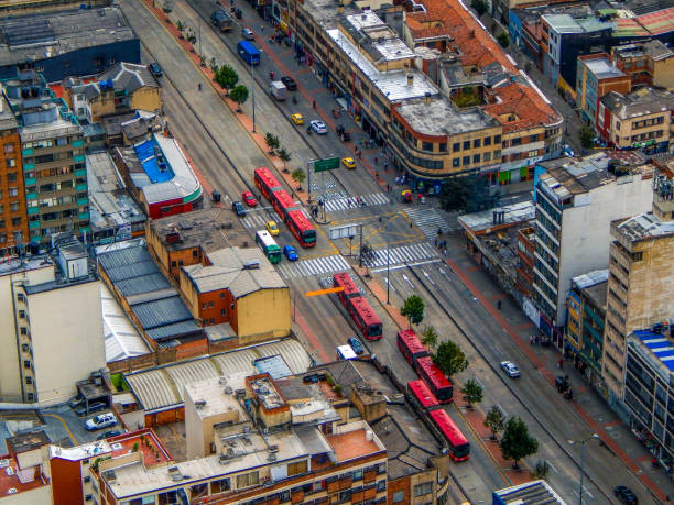 Bogota cityscape of street with transmilenio buses Bogota cityscape of street with transmilenio buses bus rapid transit stock pictures, royalty-free photos & images