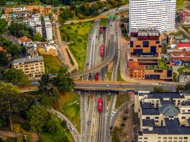 Bogota cityscape with streets and bridges and intersections Bogota cityscape with streets and bridges and intersections bus rapid transit stock pictures, royalty-free photos & images