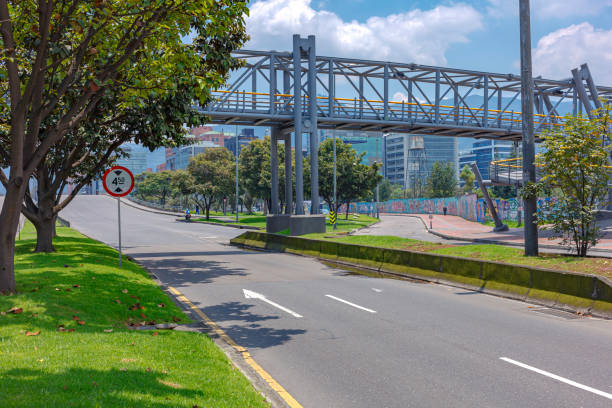 Bogota, Colombia: Calle 100 As It Approaches The Bridge Over The Autopista Norte In The La Castellana District Of The Capital City. It Is Deserted Due To The Coronavirus Lockdown In The Country stock photo
