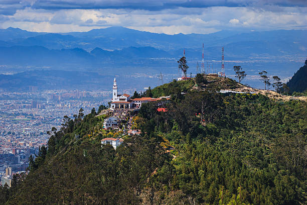 Bogota, Colombia: Exceptional High Angle View Of Monserrate from Andean Peak Of Guadalupe From Over 11,000 Feet Above Mean Sea Level stock photo
