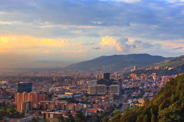 Bogota, Colombia - High Angle Panoramic View Of The Andean Capital City From The Heights Of La Calera On The Andes At Sunset Time stock photo