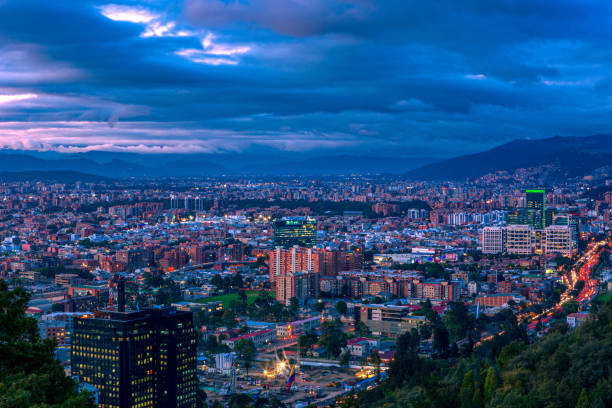 Bogota, Colombia - High Angle Panoramic View Of The Northern Part Of The Capital City As Viewed From La Calera On The Andes Mountains. stock photo