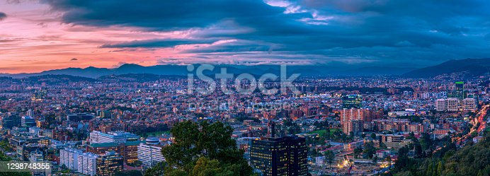 istock Bogota, Colombia - High Angle Panoramic View Of The Northern Part Of The Capital City As Viewed From La Calera On The Andes Mountains. 1298748355
