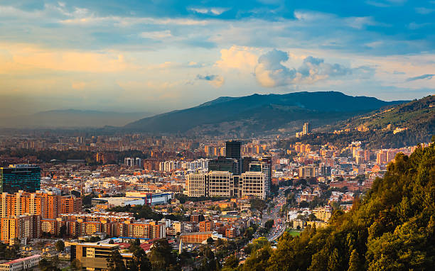 bogota, colombia - high angle view of bario de usaquén from the heights of la calera on the andes mountains at sunset time - colombia stock photos and pictures