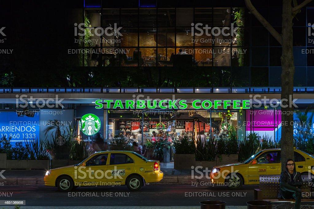 Bogota, Colombia: Starbucks Coffee Shop on Calle 93A, night photo stock photo