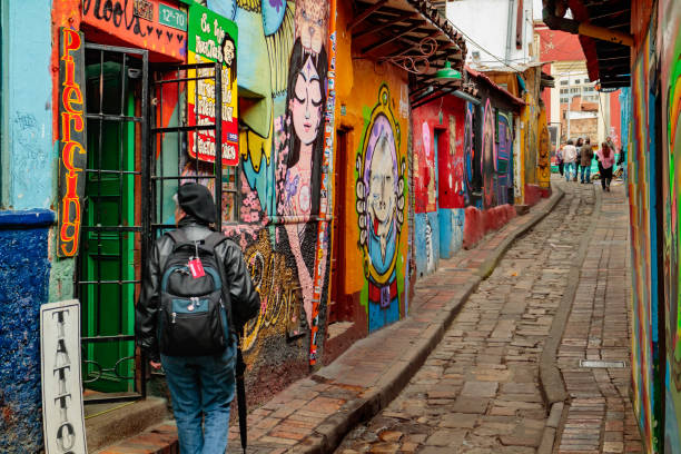Bogota, Colombia - Tourists and Local Colombians on the Calle del Embudo, in the Historic La Candelaria District of the Andean Capital City stock photo