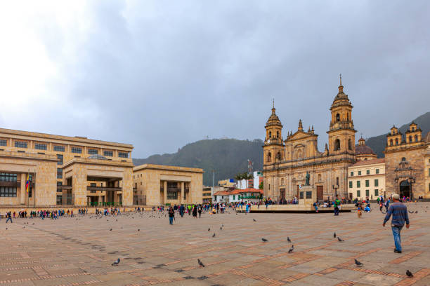 Bogota, Colombia - View Across Plaza Bolivar, To The Northeastern Corner Of The Square - The Supreme Court To The Left, Catedral Primada And Capilla del Sagrario To The Right, And Colombians Going About Their Everyday Life, In The Andean Capital City. stock photo