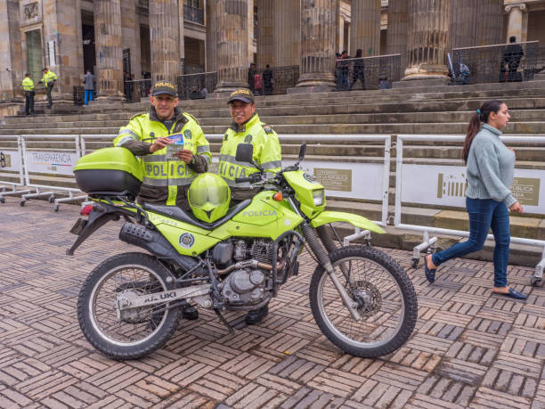 Bogota Bogota, Colombia - September 13, 2013: A policemen with motor in yellow uniform in front of National Capitol. Bolivar Square, La Candelaria. trooper stock pictures, royalty-free photos & images