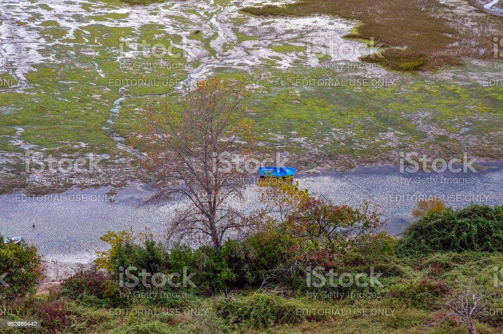 Bogs and blue boat in San Vicente de la Barquera, Cantabria, Spain stock photo