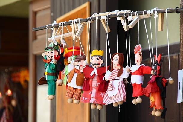 Bohemia, Cesky Krumlov, Czech Republic - May 21, 2011 - Dolls Bohemia, Cesky Krumlov, Czech Republic - May 21, 2011 - Traditional dolls, Souvenir for tourist. puppet stock pictures, royalty-free photos & images