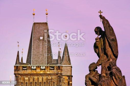Bohemia, Prague (Praha), Czech Republic (Ceska Republika) - May 23, 2011 - Statue of St. Francis Xavier on Charles bridge (Karluv Most) with old town bridge tower in background.