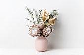 istock Bohemian dried flower arrangement in a stylish pink vase. 1276935068