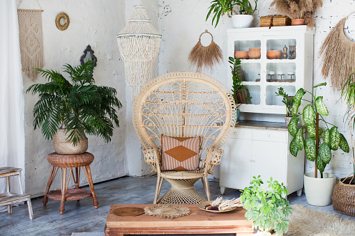 Bohemian interior with peacock armchair