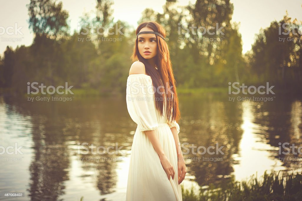 Bohemian lady at river stock photo