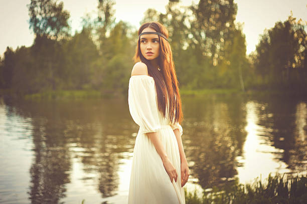 bohemian lady at river - hippie fashion stock photos and pictures