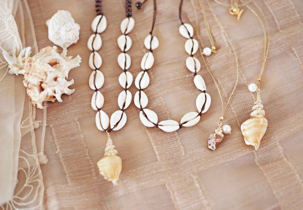 bohemian summer jewelry with shells - cowrie shells necklaces - fashion jewelry advertisement stock photo