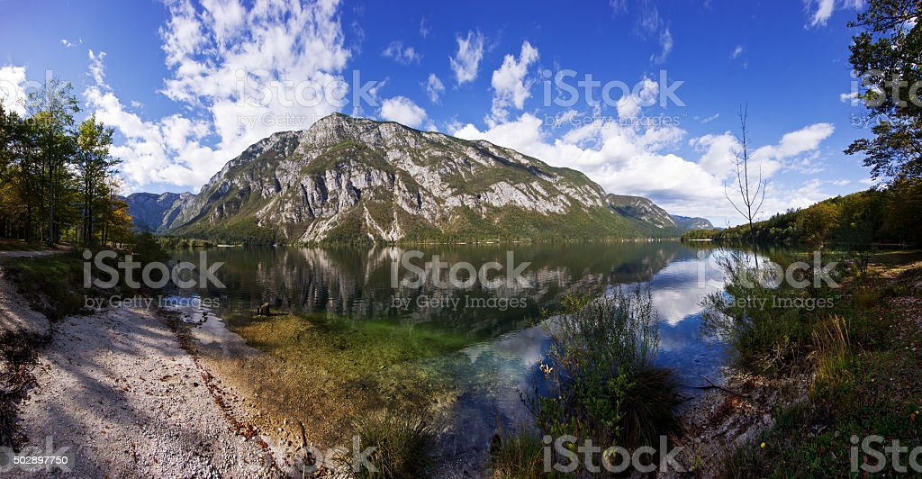 Bohinj lake and mountains.  Panorama of wild landscape, natural environment stock photo