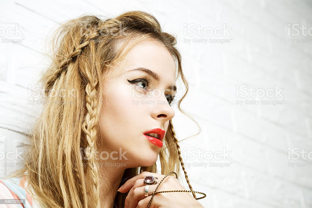 Boho Fashion Girl at White Brick Wall Background stock photo