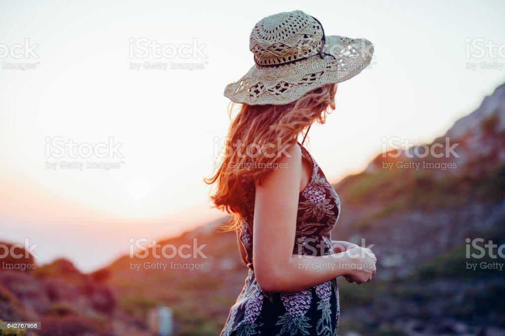 Boho girl enjoying nature with summer sunflare stock photo