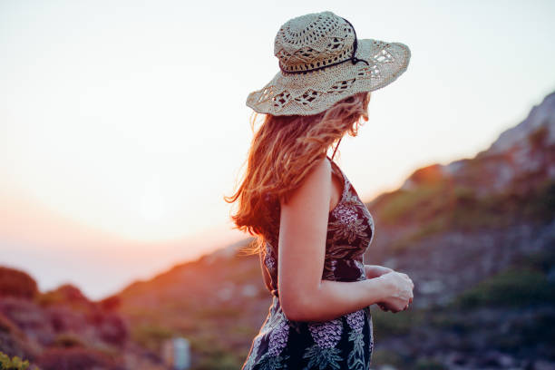 boho girl enjoying nature with summer sunflare - country fashion stock photos and pictures