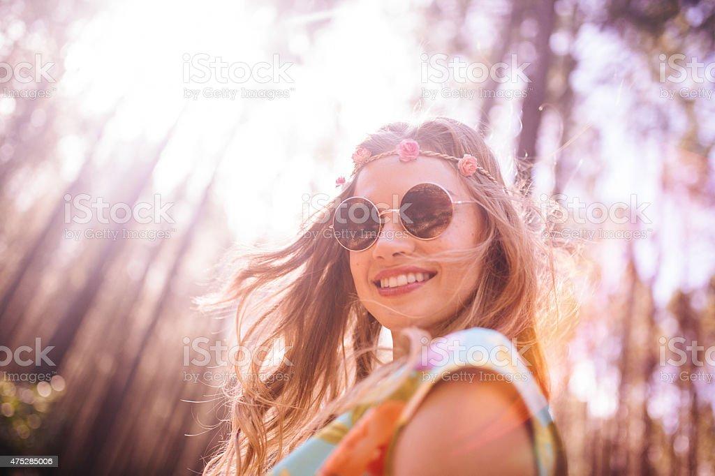Boho girl in flower headband and round sunglasses stock photo