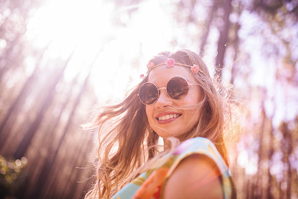 boho girl in flower headband and round sunglasses - hippie fashion stock photos and pictures