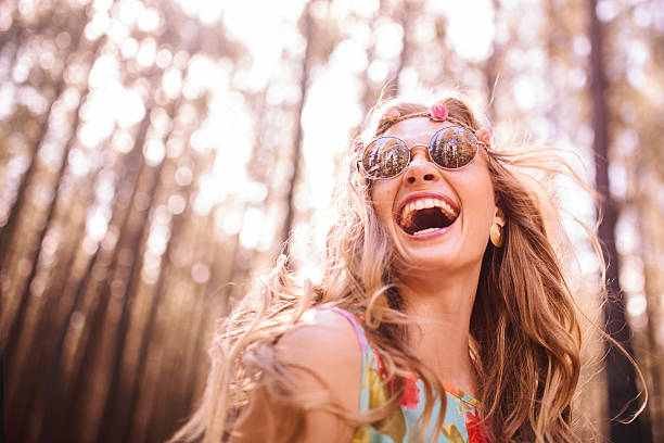boho girl laughing in a summer forest - hippie fashion stock photos and pictures