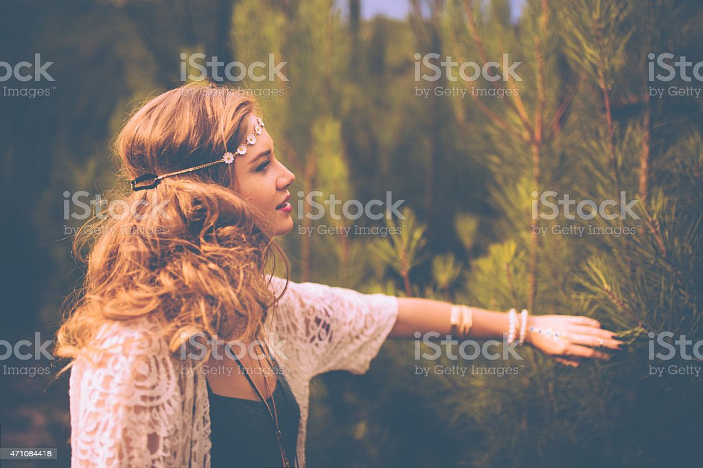 Boho girl surrounded by nature in summer stock photo