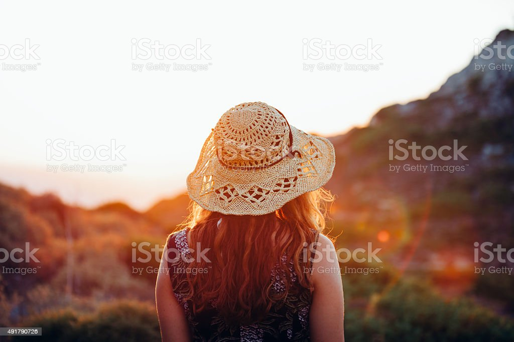 Boho girl walking and enjoying nature with summer sunflare Boho style young woman in vintage dress walking and having fun in forest with summer sun setting lens flare background 20-29 Years Stock Photo