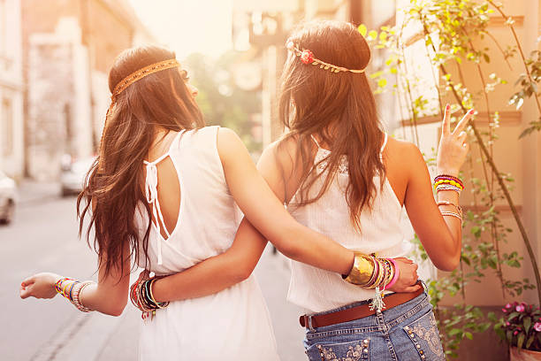 boho girls walking in the city - hippie fashion stock photos and pictures
