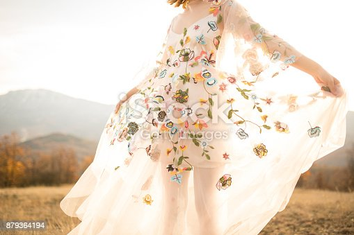 istock Boho lady in a white romantic dress outdoors 879364194