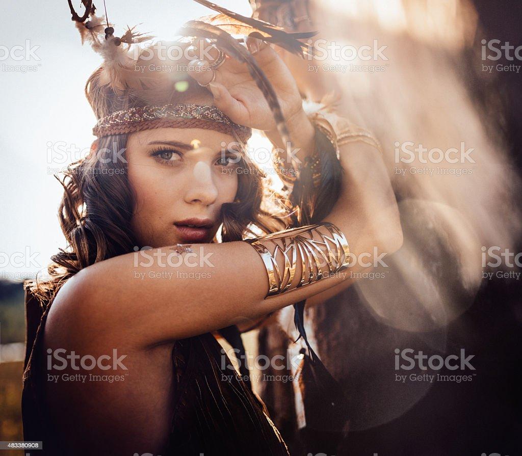 Boho style girl outdoors with sun flare stock photo