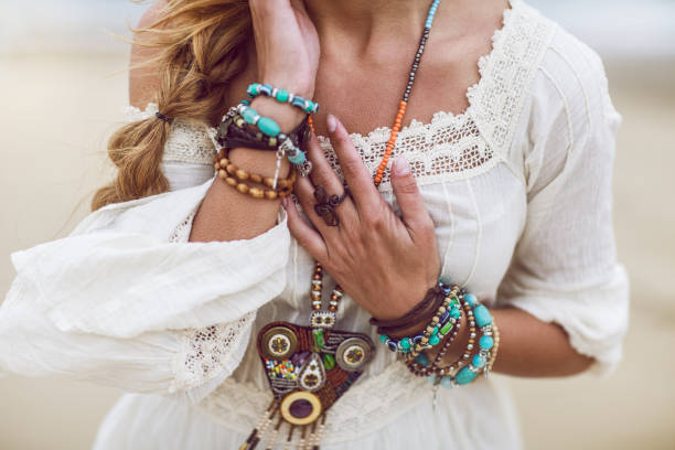 Boho woman with multicolored jewelry – zdjęcie