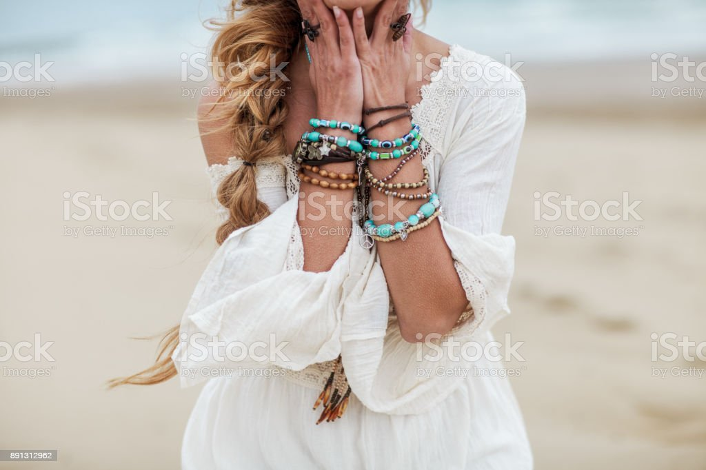 Boho woman with multicolored jewelry stock photo