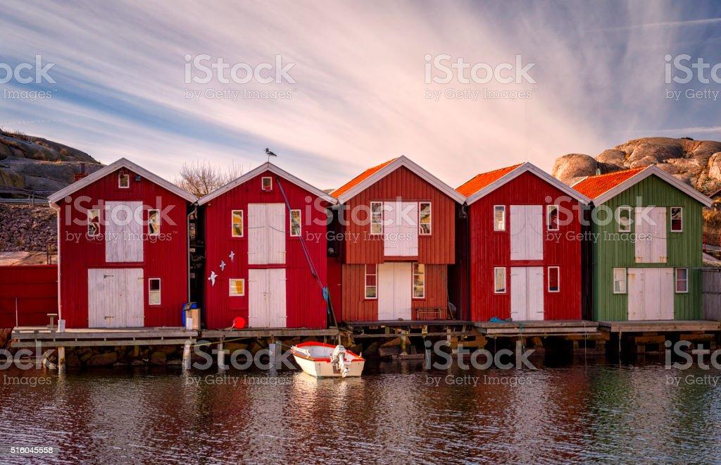 Bohuslan boathouses in morning light stock photo