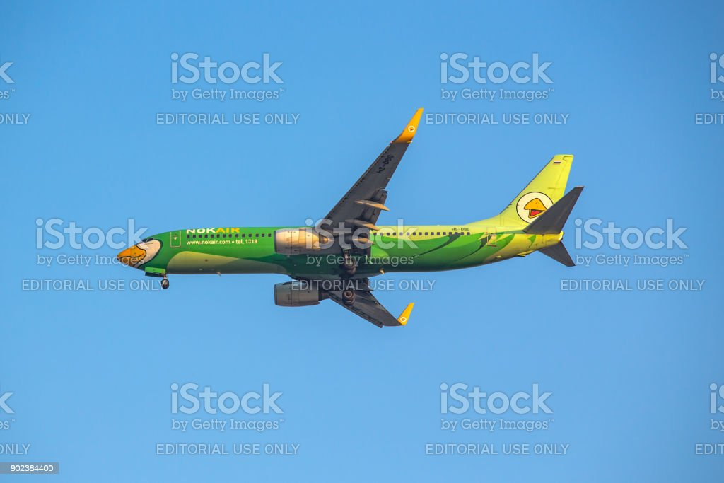 Boieng 737 - 800 HS-DBG of NOK Air landing to runway 03L Don Mueang International Airport Thailand. stock photo