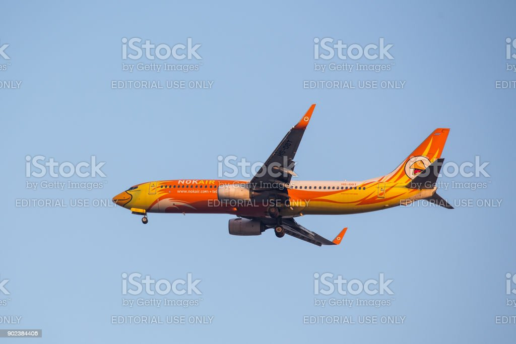 Boieng 737 - 800 HS-DBT  'Budhnampetch' of NOK Air landing to runway 03L Don Mueang International Airport Thailand. stock photo