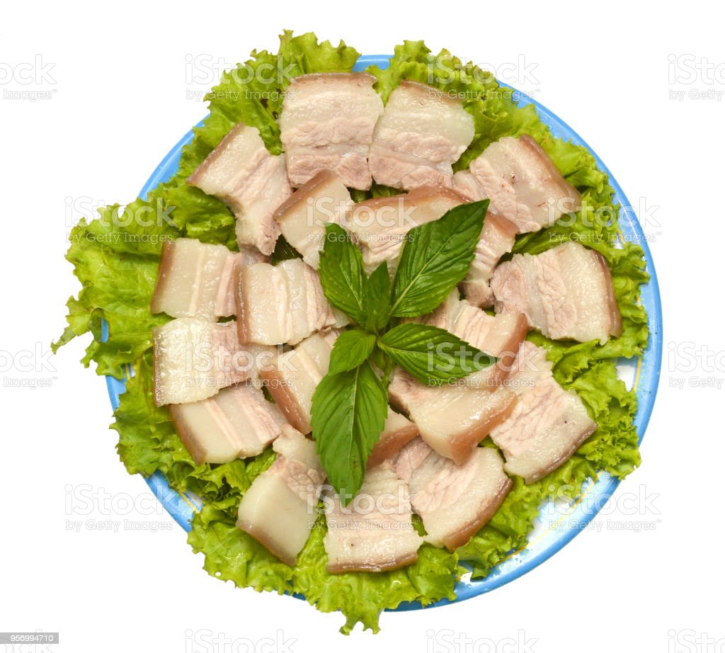 Boil suckling pig cut as small piece on banana leaved stock photo