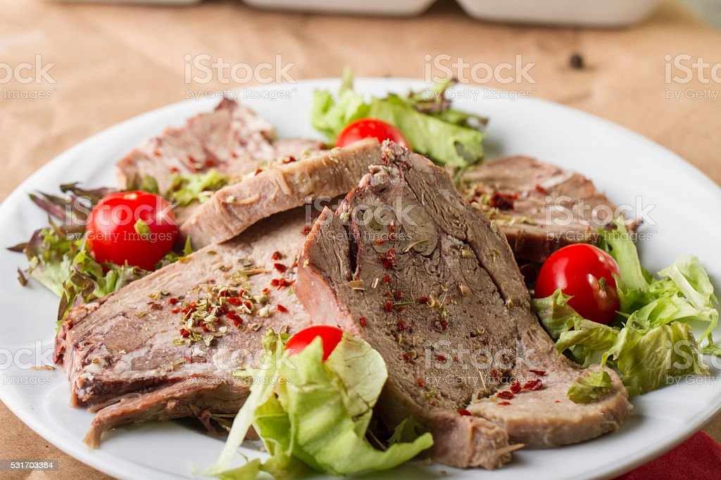Boiled beef tongue ( dil sogus ) on wood background stock photo