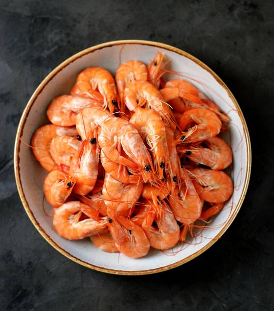 Boiled big sea prawns (shrimps). Healthy food. Top view. Copy space. stock photo