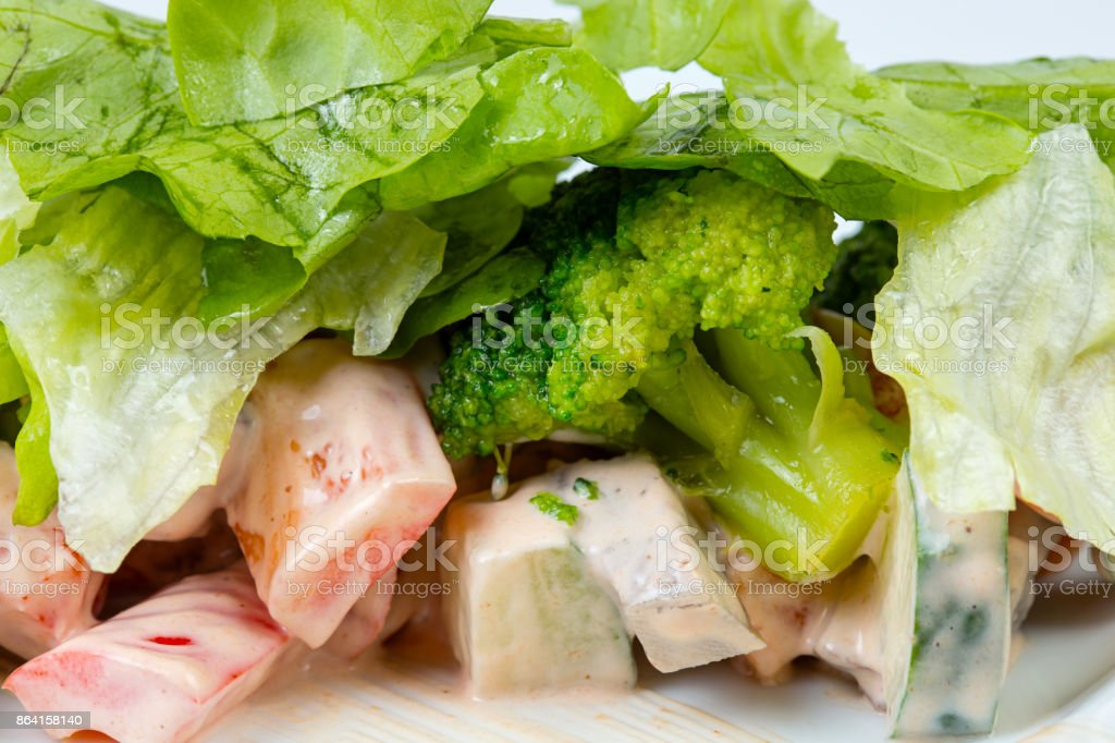 Boiled broccoli with green salad royalty-free stock photo