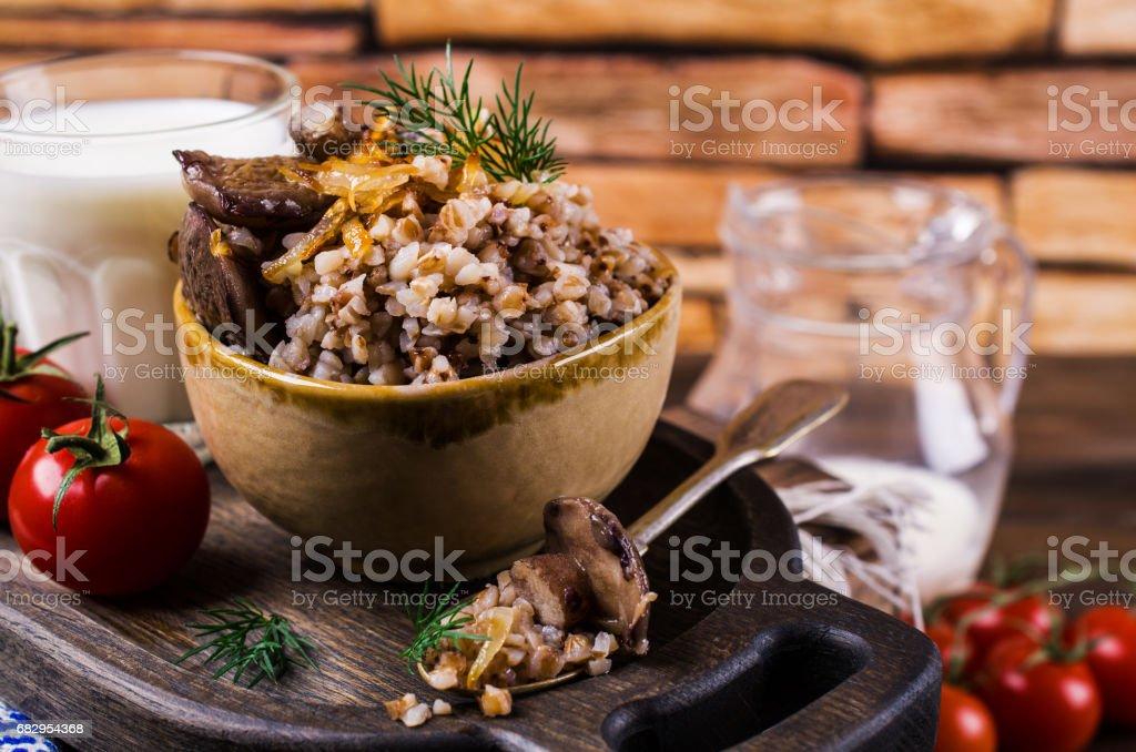 Boiled buckwheat with mushrooms royalty-free stock photo