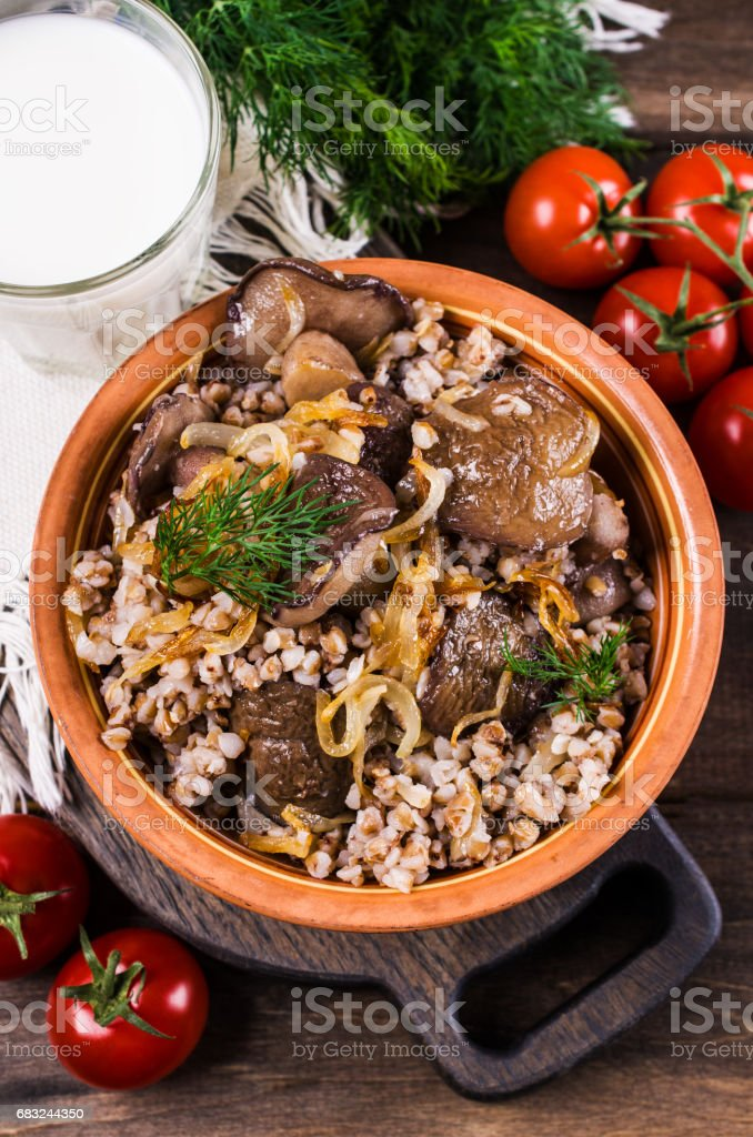 Boiled buckwheat with mushrooms royalty-free stock photo