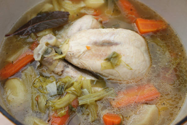 Boiled chicken  French gastronomy Boiled chicken  French gastronomy pot au feu stock pictures, royalty-free photos & images